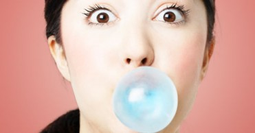 getty_rf_photo_of_woman_blowing_bubble[1]